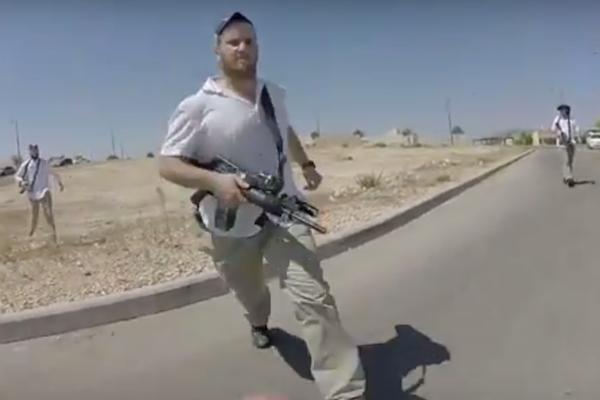 A members of Carmel's settler rapid response team attacks Israeli left-wing activist Guy Butavia, September 16, 2017.