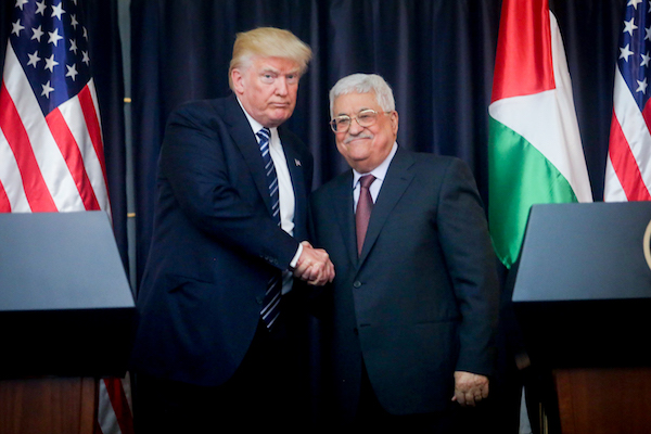 Palestinian President Mahmoud Abbas and U.S. President Donald Trump shake hands in the West Bank city of Bethlehem, May 23, 2017. (Flash90)