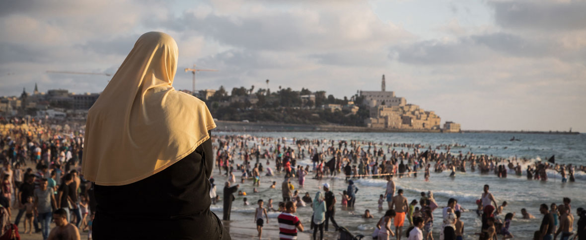 The beach in Jaffa with the Old City in the background. (Yaakov Lederman/Flash90)