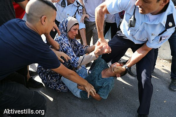 Police arrest a minor during a protest against the eviction of the Shamanseh family from their home in the East Jerusalem neighborhood of Sheikh Jarrah, September 8, 2017. (Oren Ziv/Activestills.org)
