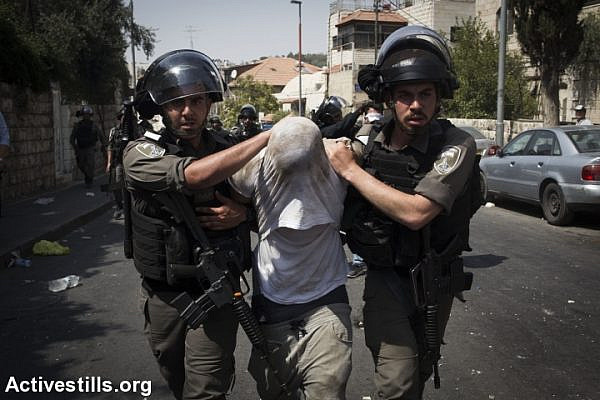 Illustrative photo of Israeli Border Police officers frogmarching a Palestinian detainee in East Jerusalem during the tension surrounding Al-Aqsa Mosque, July 21, 2017, East Jerusalem. (Oren Ziv/Activestills.org)