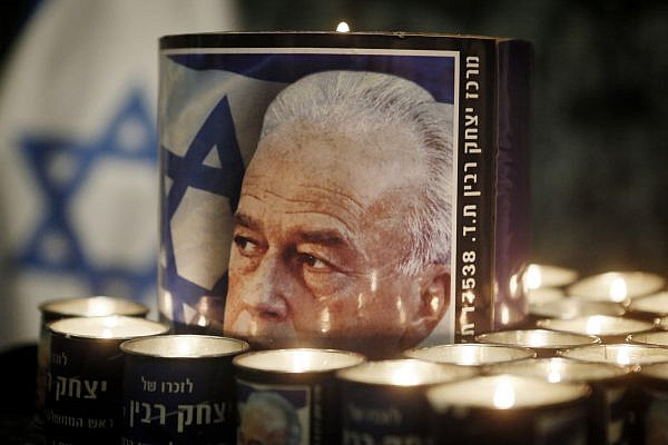 Candles with a picture of late Israeli Prime Minister Yitzhak Rabin, at a memorial ceremony to commemorate the18th anniversary of Rabin's assassination, at the president's house in Jerusalem on October 15, 2013. Photo by Miriam Alster/FLASH90