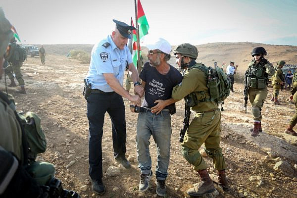 Palestinians and Israeli activists attend a demonstration against the construction of Jewish settlements in the Jordan Valley, West Bank. November 17, 2016. (Flash90)