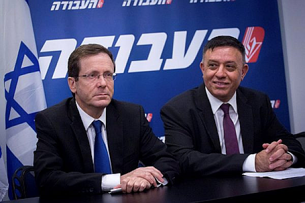 Newly elected head of the Israeli Labour party, Avi Gabbay, with outgoing Chairman Isaac Herzog. (Miriam Alster/ FLASH90)