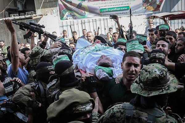 Fighters from the Qassam Brigades, the armed wing of the Palestinian Hamas movement, carry the body of 30-year-old Maslih Shabir in Khan Yunis, in the southern Gaza Strip, during the funeral of Palestinians who were killed the previous day in an Israeli operation to blow up a tunnel stretching from the Gaza Strip into Israel, October 31, 2017. (Abed Rahim Khatib/Flash90)