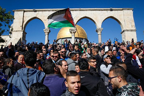 Palestinians shout slogans during a protest against U.S. President Donald Trump's announcement recognizing Jerusalem as the capital of Israel, following Friday prayers at the Al Aqsa compound in Jerusalem's Old City, December 8, 2017. (Sliman Khader/Flash90)