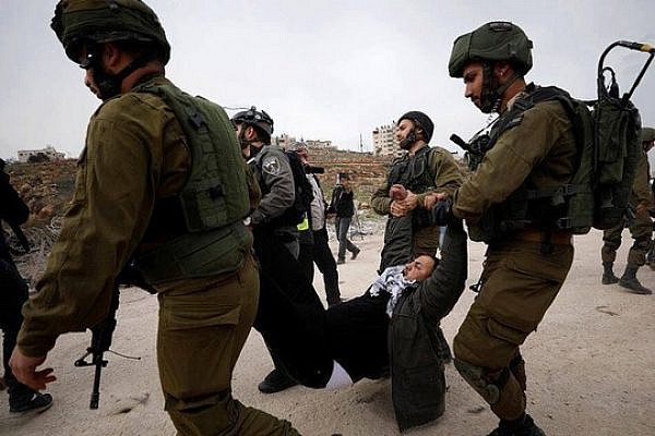 Israeli soldiers arrest Jamil Barghouti while protesting outside Ofer Military Court in support of the Tamimi women, December 28, 2017. (Courtesy of PSCC)