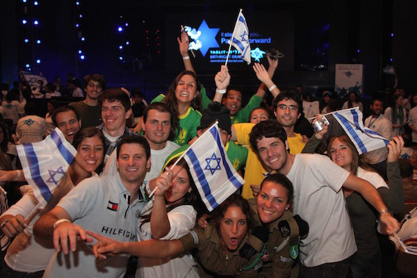 Young Jews participating in the Taglit Birthright program at an event held at the International Conference Center in Jerusalem. (Marc Israel Sellem/Flash90)