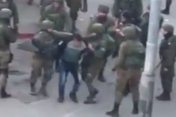 Israeli soldiers caught beating up a handcuffed Palestinian during demonstrations in Hebron against Trump's Jerusalem declaration. (Screenshot)