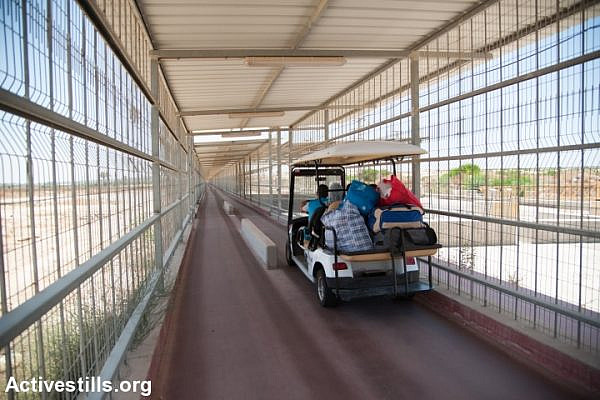 An electric cart provides transportation through the 900-meter caged terminal spanning the restricted access zone at the Erez border crossing between Israel and the Gaza Strip, July 2, 2012. (Ryan Rodrick Beiler)