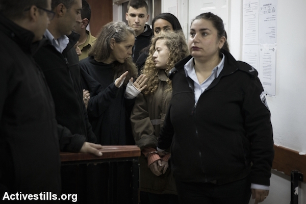 Israeli lawyer Gaby Lasky (C-L) speaks with her client sixteen-years-old Ahed Tamimi (2R) before she stands for a hearing in the military court at Ofer military prison near the West Bank of Ramallah, January 1, 2018. (Activestills)