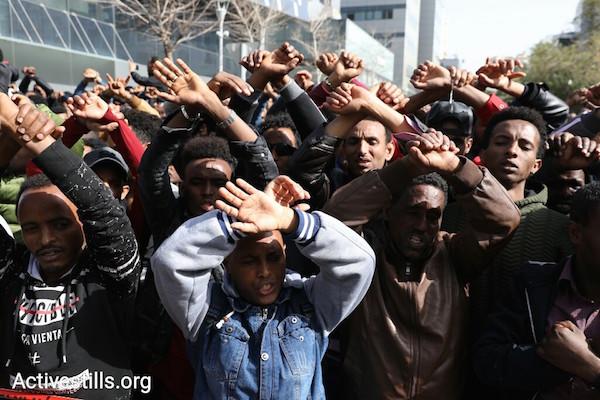 Thousands of asylum seekers protest outside the Rwandan embassy in Herzilya, Monday, January 22, 2018. (Oren Ziv/Activestills.org)