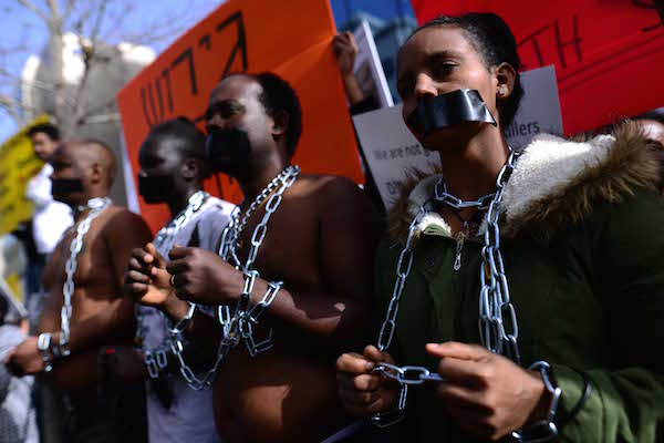 African asylum seekers and human rights activists protest against deportation in front of the Rwandan Embassy in Herzliya, on January 22, 2018. (Tomer Neuberg/Flash90)