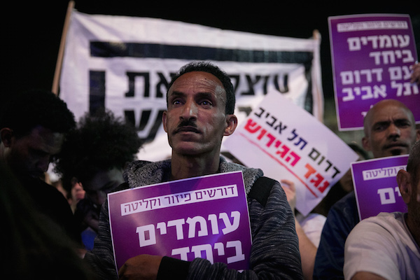 African asylum seekers and human rights activists protest against deportation of asylum seekers at Rabin Square in Tel Aviv on March 24, 2018.  (Alster/Flash90)