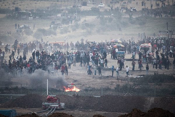Palestinian protesters in Gaza demonstrate near the border with Israel, during the eighth day of the 'Gaza Return March,' April 6, 2018. (Oren Ziv/Activestills.org)