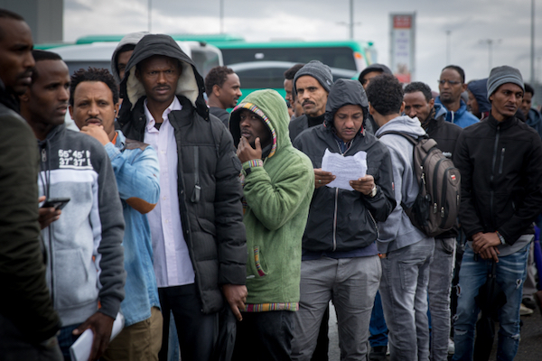 African asylum seekers wait outside an Israeli immigration office in the central city of Bnei Brak, where authorities began handing out deportation orders, February 13, 2018. (Miriam Alster/Flash90)