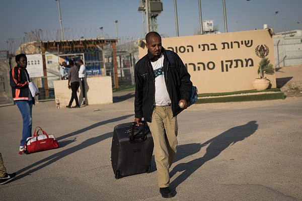 An african asylum seeker who had been detained at the Saharonim prison for refusing to be reported, leaves prison after the High Court ruled there was no legal justification to keep them in detention. April 15, 2018. (Hadas Parush/FLASH90)