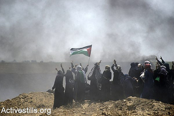 A group of Palestinian women demonstrate during a protest on the Gaza border, May 14, 2018. (Mohammed Zaanoun/Activestills.org)