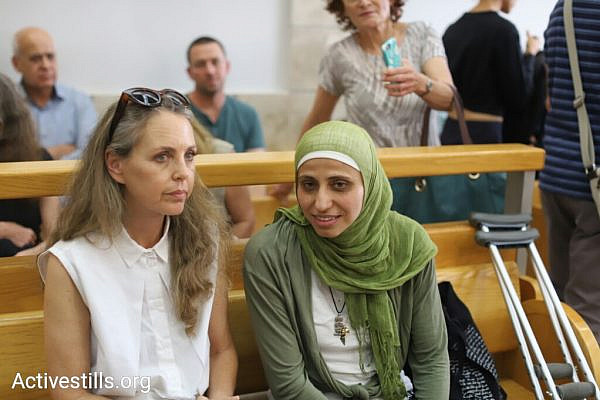 Palestinian poet Dareen Tatour (right) seen with her attorney, Gaby Lasky, at the Nazareth Magistrate's Court on May 3, 2018. Tatour was convicted of incitement and support for terrorism after publishing a number of poems on Facebook in 2015. (Oren Ziv/Activestills.org)