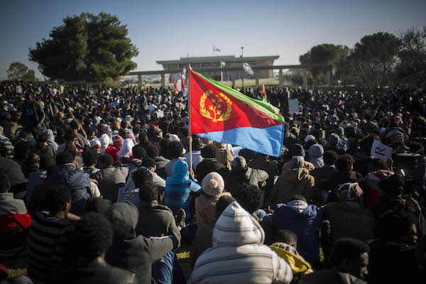 The Eritrean flag flies during a protest outside the Israeli parliament in Jerusalem on January 08, 2014. (Yonatan Sindel/Flash90)