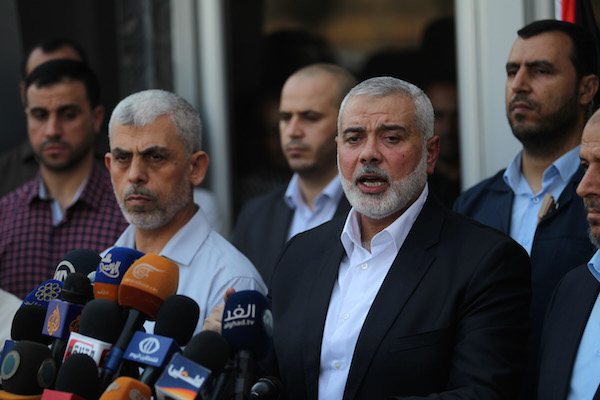 Hamas Chief Ismail Haniyeh speaks to the press upon his arrival at the Rafah border crossing, after reconciliation talks in Egypt with the Fatah movement mediated by Egyptian intelligence, in the southern Gaza Strip, September 19, 2017. (Abed Rahim Khatib/ Flash90)