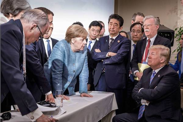 Angela Merkel faces down Donald Trump at the G7 Summit, June 9, 2018. (Jesco Denzel/German gov't)