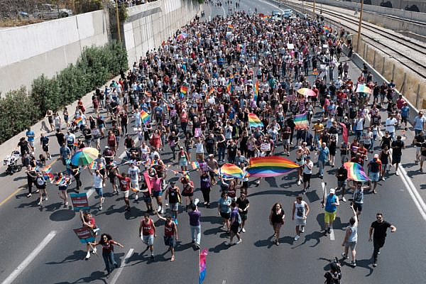 Members of the LGBTQ community and supporters block Ayalon Highway to protest a Knesset bill denying surrogacy for same-sex couples, Tel Aviv on July 22, 2018. (Tomer Neuberg/Flash90)