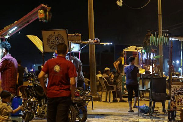 Street vendors seen on the Gaza promenade. (Mohamed Al Hajjar)