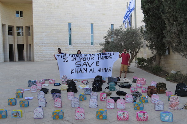 All That's Left activists place backpacks outside Israel's Supreme Court to protest the decision to demolish the village of Khan al-Ahmar, including its eco-friendly school, which serves the local Bedouin population, Jerusalem, July 10, 2018. (Courtesy of All That's Left)