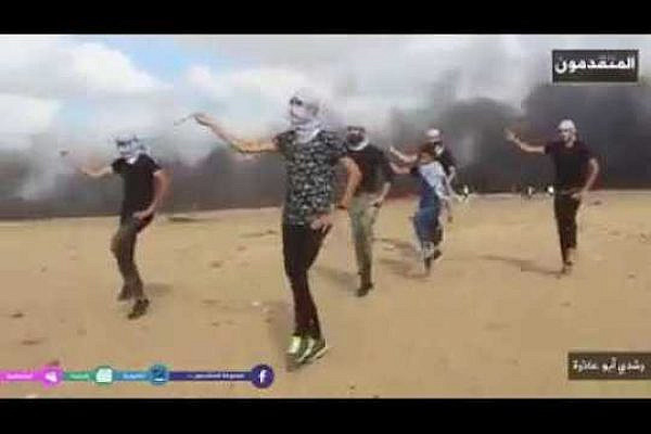 Palestinian youth dance the dabke along the Gaza border. (Screenshot)