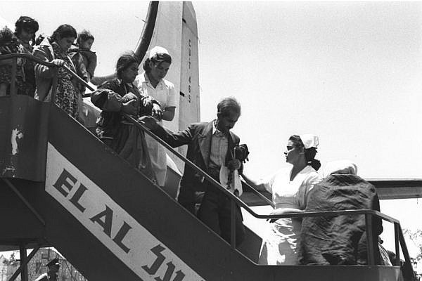 Immigrants from Iraq and Kurdistan exit their plane on arrival in Israel, having flown via Tehran, late spring 1951. (Teddy Brauner, GPO)