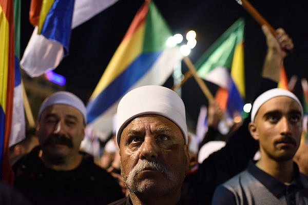 Elders of the Israeli Druze community are seen at a mass protest against the 'Jewish Nation-State law' in Rabin Square, Tel Aviv, August 4, 2018. (Gili Yaari/Flash90)