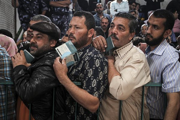 Palestinians wait at the Rafah border crossing with Egypt, in the southern Gaza Strip, after it was opened for two days by Egyptian authorities, May 11, 2016. (Abed Rahim Khatib/ Flash90)