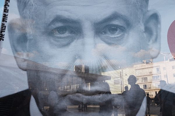A giant portrait of Israeli Prime Minister Benjamin Netanyahu at a protest against the Jewish Nation-State Law, Tel Aviv, July 30, 2018. (Tomer Neuberg/Flash90)