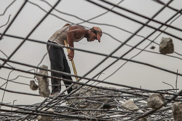A Palestinian laborer works amongst the rubble of destroyed Palestinian houses damaged during the Israeli-Hamas conflict of 2014, in the Al-Shejaeiya neighbourhood in the east of Gaza City, Gaza Strip, 09 September 2015. According to UN reports, there were 2,251 Palestinians killed between June and August of 2014, about half of them civilians. It also counted six civilians in Israel and 67 Israeli soldiers among the victims of the conflict. Photo by Emad Nassar/Flash90