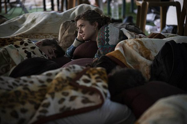 Hailey Mann, a Jewish-American member of All That's Left, wakes up after spending the night in the schoolyard of Khan al-Ahmar, the Palestinian village Israel plans to completely destroy any day now, September 16, 2018. (Oren Ziv/Activestills.org)