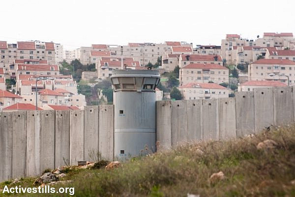 The Israeli separation wall surrounds the East Jerusalem settlement of Pisgat Ze'ev, April 9, 2011. (Activestills.org)