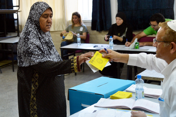 An Arab woman casts her vote at a polling station in the city of Lyd on October 22, 2013. (Yossi Zeliger/Flash90)