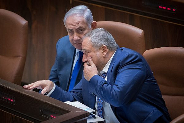 Prime Minister Benjamin Netanyahu and Defense Minister Avigdor Liberman attend a special plenary memorial for the late, former minister, Rehavam Ze'evi Gandi, at the Knesset, on October 24, 2017. (Yonatan Sindel/Flash90)