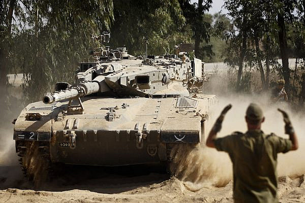 Illustrative file photo of Israeli troops deployed along the Gaza border. (Miriam Alster/Flash90)