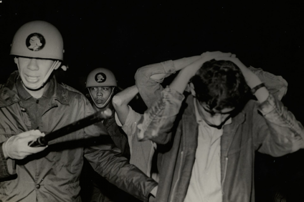 Brazilian police arrest a student protesting the military dictatorship, June 20, 1968. (Brazilian National Archives)