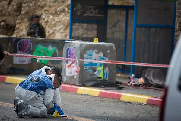 Israeli security forces at the scene of a shooting attack at the entrance to the Israeli settlement of Givat Asaf, in the West Bank, on December 13, 2018. Two soldiers were killed and several others wounded. Photo by (Hadas Parush/Flash90)