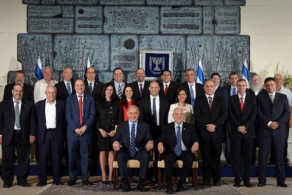 The ministers of the thirty-fourth government of Israel, alongside Prime Minister Benjamin Netanyahu and President Reuven Rivlin. (Avi Ohayon/GPO)
