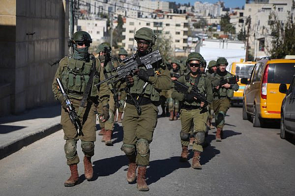 Israeli soldiers marching through the streets of Ramallah, occupied West Bank, December 15, 2018. (Flash90)