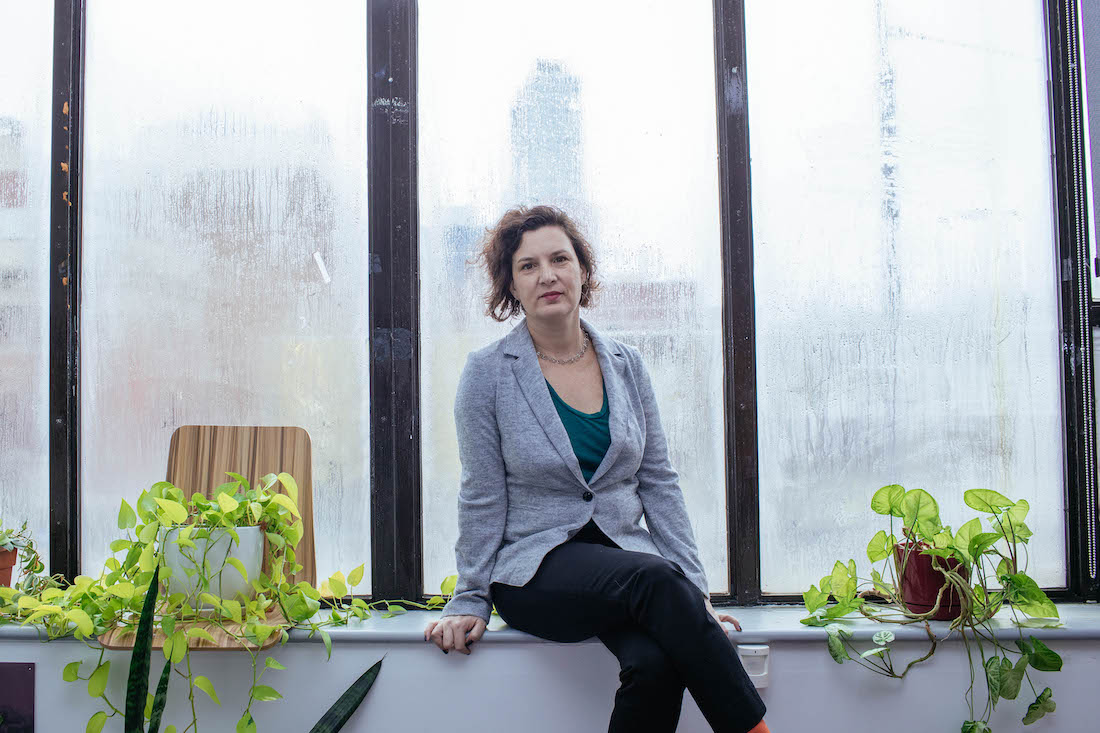 Rebecca Vilkomerson, Director of Jewish Voice for Peace, at the organization's offices in Brooklyn, NY, January 23, 2019 (Kevin Hagen for +972 Magazine)