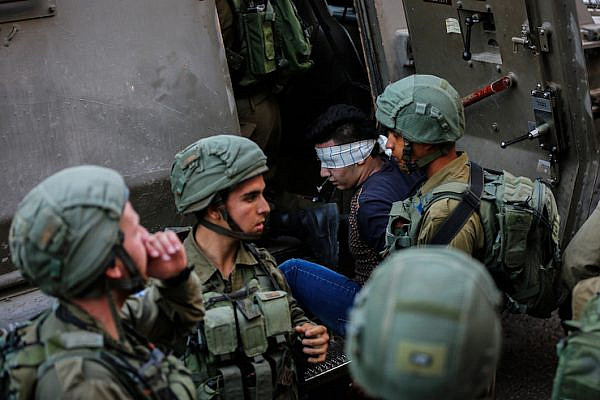 Illustrative photo of Israeli soldiers arresting a young Palestinian man, Hebron, West Bank, September 20, 2017. (Wisam Hashlamoun/Flash90)