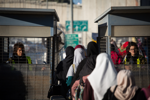 Palestinian women cross the Qalandiya checkpoint, outside of the West bank city of Ramallah, on June 23, 2017. (Hadas Parush/Flash90)