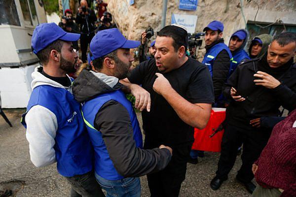 Israeli Settler Ofer Ohana argues with Palestinian activists in the West Bank city of Hebron, February 10, 2019. (Wisam Hashlamoun/Flash90)