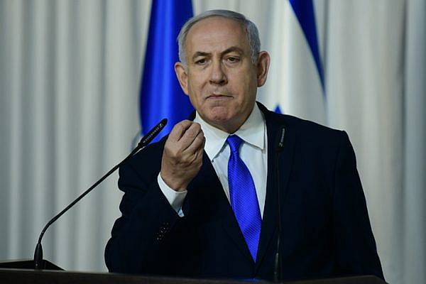 Prime Minister Benjamin Netanyahu delivers a statement to the media in Kfar Maccabiah, Ramat Gan on February 21, 2019. (Tomer Neuberg/Flash90)