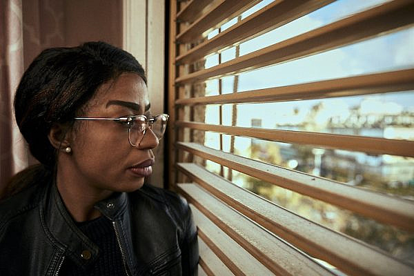 Julie Wabiwa Juliette, a Congolese asylum seeker, seen in her apartment in Holon, just south of Tel Aviv. 'I am afraid for my life, for my family, and for my kids.' (Ben Toren)